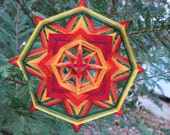 Fire of life a 12  inch Ojo de Dios, in stock by Inga Savage