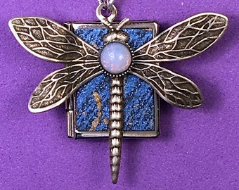 Dragonfly Peace Book, blue and silver, with 14 translations of the word peace inside