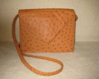 Leather, beautifully tooled shoulder or cross body bag