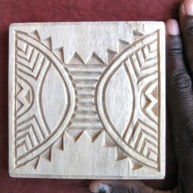Hand carved wood printing blocks made in namibia by oshiwa