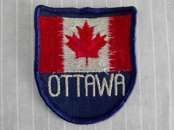 Used slightly shabby vintage sew on ottawa patch