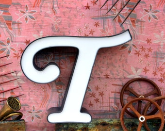 Vintage Marquee Sign Letter Capital 'T': Black & White Wall Hanging Initial in Unusual Italic Font -- Industrial Neon Channel Advertising