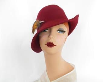 Maroon fedora hat, vintage tilt with feathers