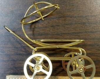 Brass baby buggy
