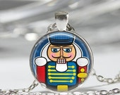 ON SALE Christmas Jewelry Nutcracker Necklace Holiday Art Pendant in Bronze or Silver with Link Chain Included