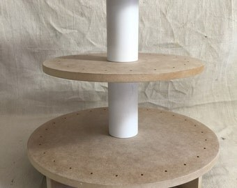 3 tier round unfinished cake pop stand with X base.  Holds up to 61 cake pops.