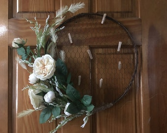Chicken wire memo/photo/wreath with beautiful floral accents.
