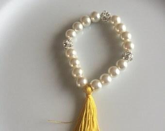 Ivory pearl bracelets with yellow silky tassel and crystal rhinestone balls, tassel bracelet, tassel bridal, yellow tassel bracelet