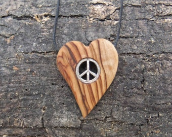 Heart shaped olive wood pendant with two inlaid peace symbols