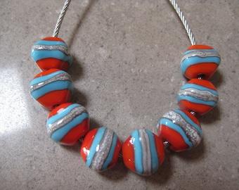 Lampwork Glass Beads. Orange and Blue Glass Diamond Beads. Silver Ivory. Handmade Glass Beads. Australian Artisan Beads. Kiln Fired Beads.
