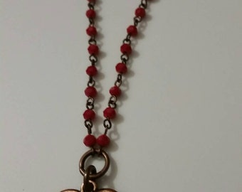 Red beaded copper heart necklace