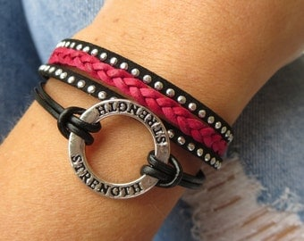 strength bracelet with leather braid in pink to support breast cancer awareness. leather bracelet with lobster clasp and extension chain.