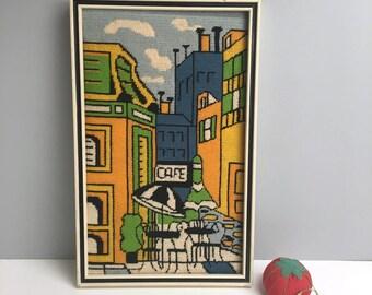 Modern sidewalk cafe framed needlepoint - stylized geometric cityscape - 1970s vintage needlework