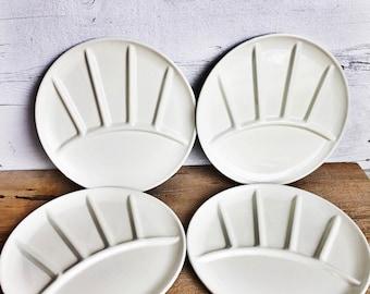 Four white enamel divided plates. Enamel ware fondue plates. Made in Japan.
