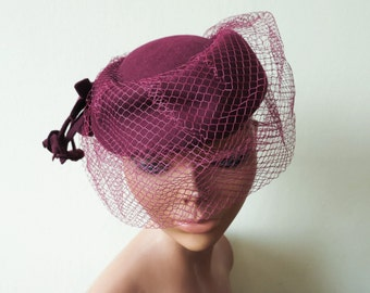 FLASH SALE vintage dark red wool felt hat with veil tassels netting ruby cocktail cap tilt hat 1980s does 1940s 40s style accessoires