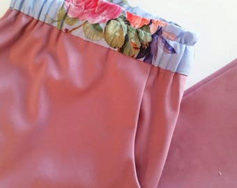 Pink sateen pants with tapered leg and elastic waistband