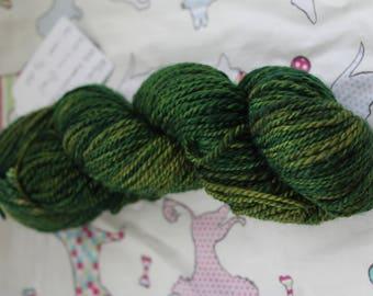Hand spun & hand dyed 100% superwash Merino yarn, green.  DK