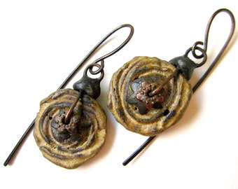 When We See the Eyes - primitive rustic stacked grungy tan ceramic spiral disc stacked rusty bead caps, tinned black metal simple earrings