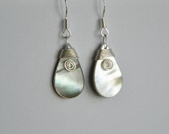 Mother of pearl earrings with sterling silver koru binding~Pacifica Moana