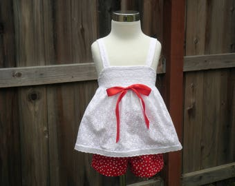 White eyelet top and red/white shorts