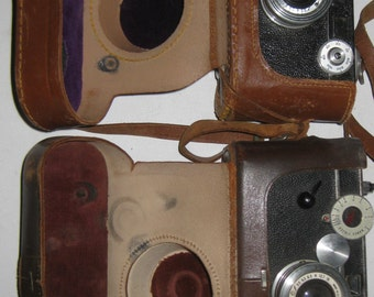 2 Argus 35mm Cameras With There Leather Case collectible