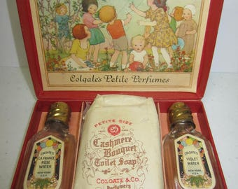 Darling boxed set of vintage 1920's Colgate & Co. Petite Perfumes soap, box shows colorful graphics of children in a garden with balloons