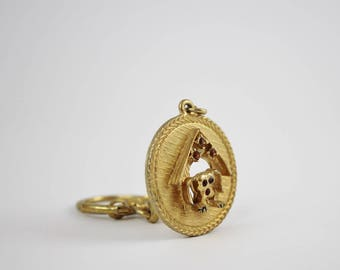 Vintage Brass Dog in Doghouse Keychain Charm with Rhinestone Details