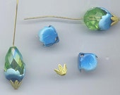 Six 2-part enameled bead caps from the Vendome design house: aqua enamel with a tiny leaf cluster in yellowish green on top - 12 x 10.5 mm