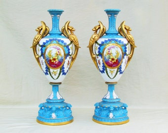 Pair of antique hand painted porcelain urns, French blue bolted urns with floral and heavy gold decoration, ornate mantlepiece urns