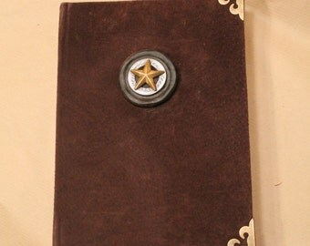 Steampunk handbound journal with Brass star mounted on a leather disc