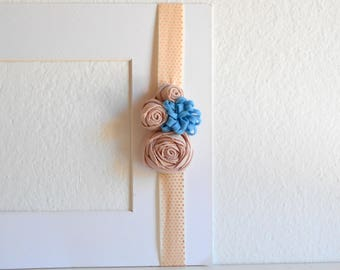 Pink and beige elastic headband with roses and fabric flowers