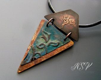 Blue patina embossed copper pendant