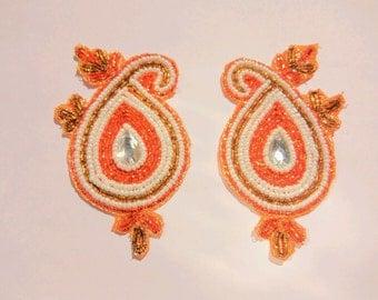 A Pair of White/Orange Paisleys - Embellishments