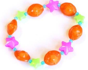 Star Child - Orange UFO Stretch Bracelet with Bright Green and Fuchsia Stars