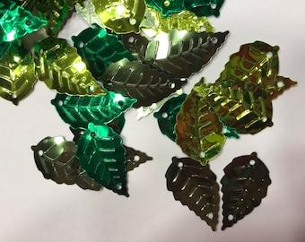 25-30 pieces assorted metalic green tone leaf sequins/ confetti mix , 13 x 25 mm (38)