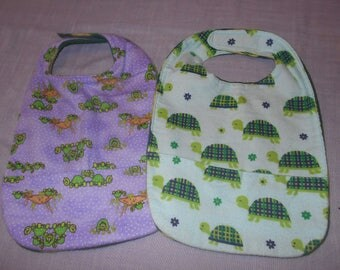 Turtle SMALL REVERSIBLE BIBS with Pocket and Velcro Fastners.