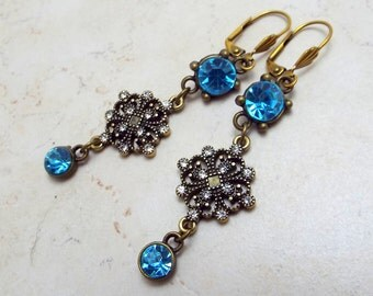 Earrings Antiqued Brass and Aqua Blue and Clear Crystal Filigree Leverbacks