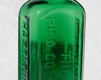 Emerald green original antique CONSUMPTION CURE quack medicine bottle from the 1800's - originally contained CANNABIS
