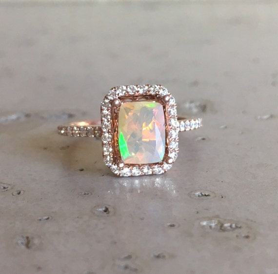 emerald cut opal engagement ring gold promise ring halo