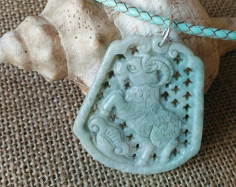 STUNNING carved jade pendant on matching leather choker