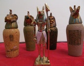 Vintage Egyptian Replicas of Canopic Jars and Anubis Figurine