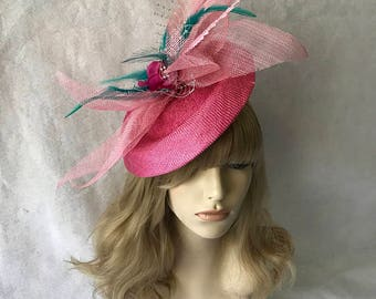 Pink sinamay fascinator hat with teal feathers, silver veiling for wedding, derby races, church, mother of the bride, and tea parties