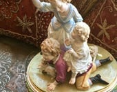 ANTIQUE PORCELAIN FIGURINE  of Children Playing with Two Dogs, Meissen Style, Signed from Paris Collected Circa 1920's