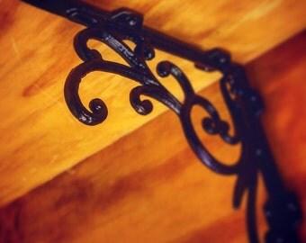 root stock wall bracket scroll pattern rustic midcentury modern fixture