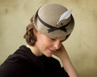 Brontë - Pen and Ink Splash literary feather fascinator in taupe faux fur