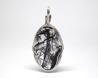 Tourmalinated quartz silver wire wrapped pendant