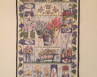 """Beautiful garden wallhanging quilt in soft blues and yellows, approx. 22"""" x 43"""", hanging sleeve included"""