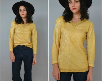 1970s golden long sleeved trimmed tunic