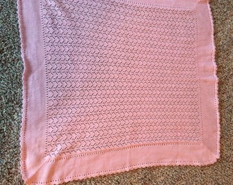 Super soft and cuddly hand knitted baby blanket. Pink.