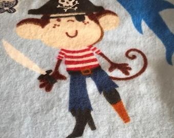 a standard pillowcase in a blue pirate print